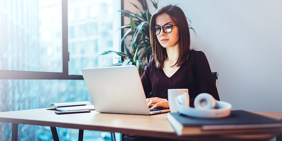woman on laptop working in office