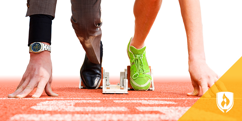 male runner and business man with feet on running block
