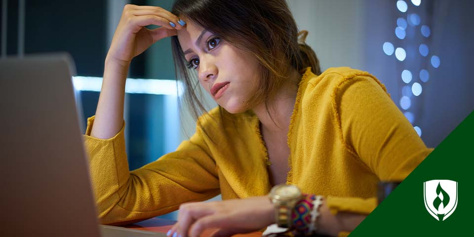 illustration of student sitting in front of computer screen under rain cloud with umbrella
