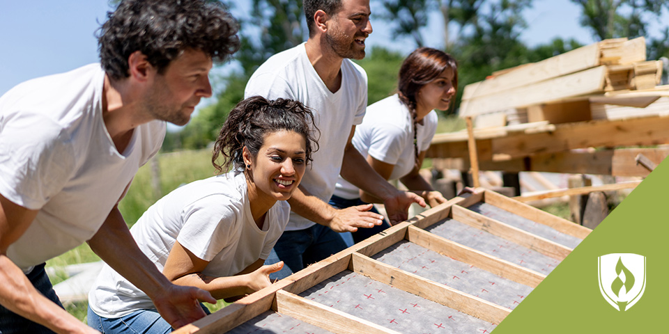group of volunteers building house