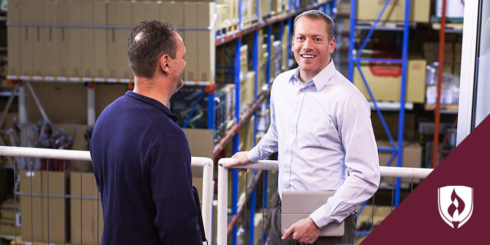 two businessmen in a warehouse