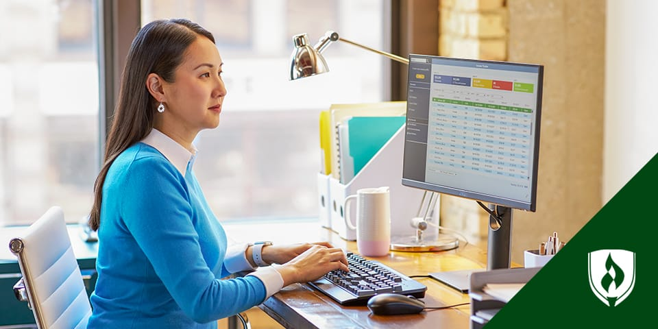 woman working with spreadsheets on computer
