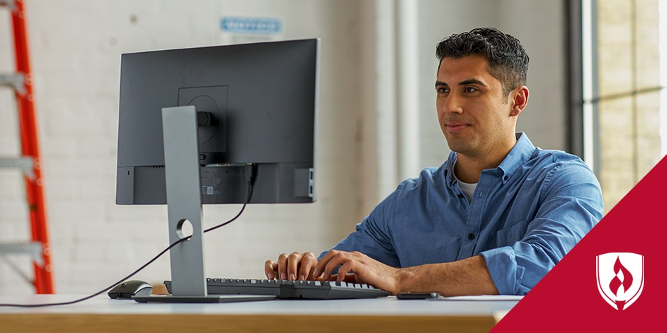 Photo of a logistics professional working at a computer