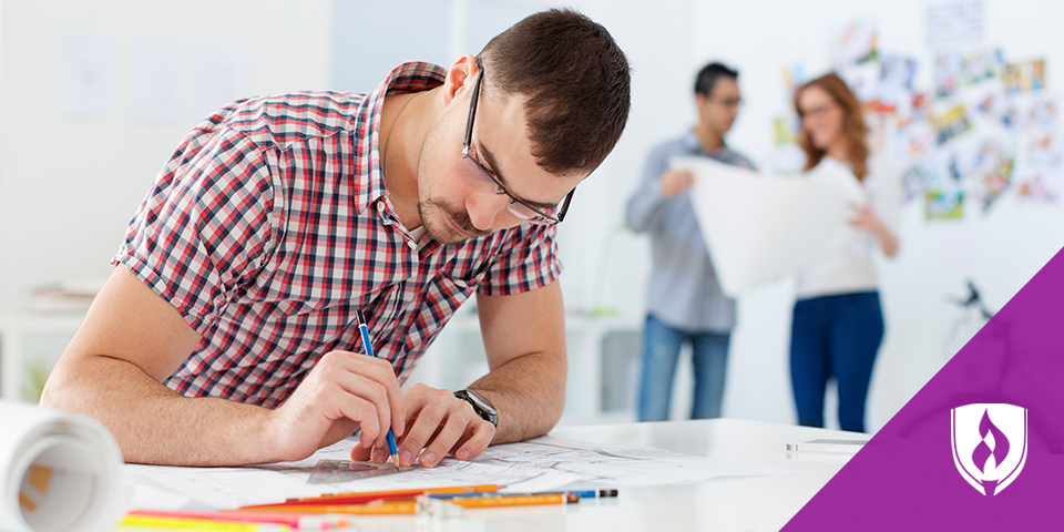 man drawing in creative work environment