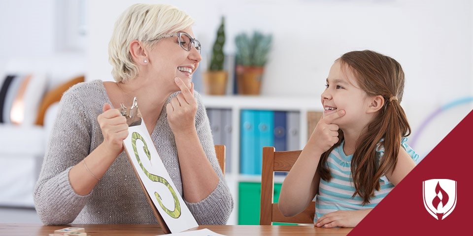woman doing speech exercises with young girl