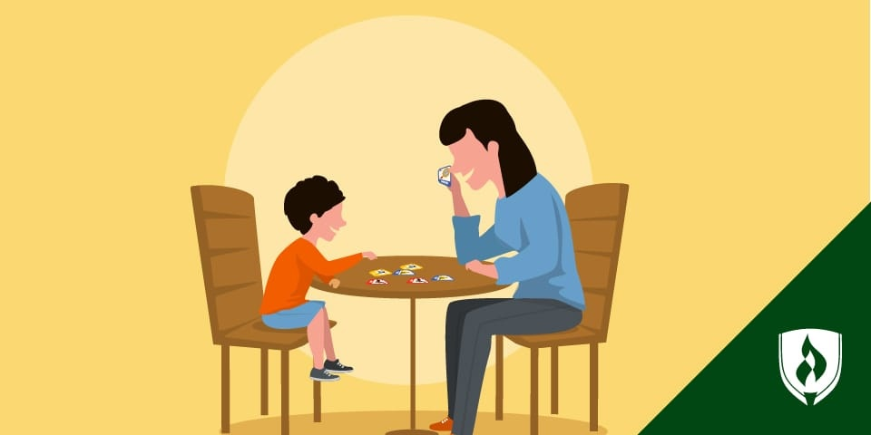 woman playing word game with young boy