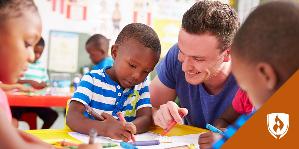 male teacher working with young boy