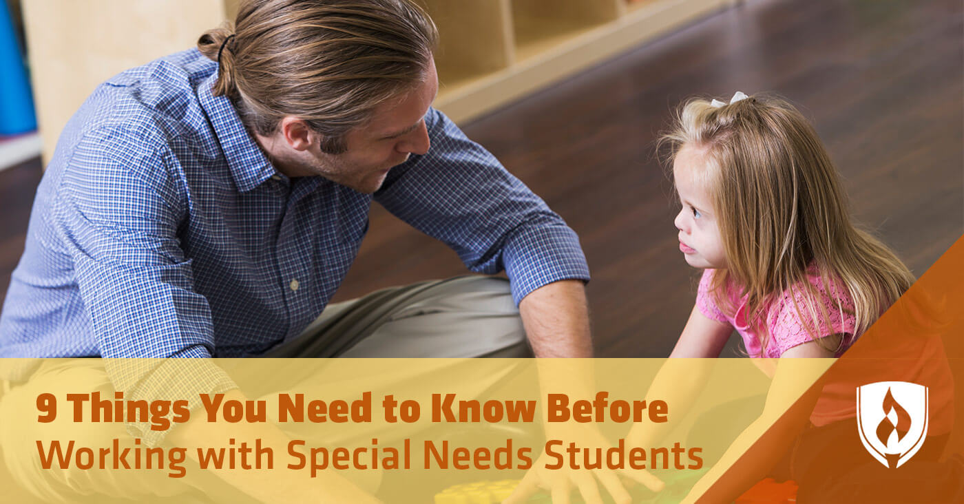 male teacher working special needs child