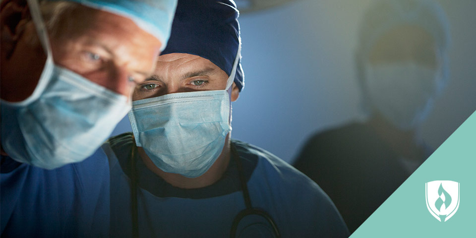 two male surgeons operating