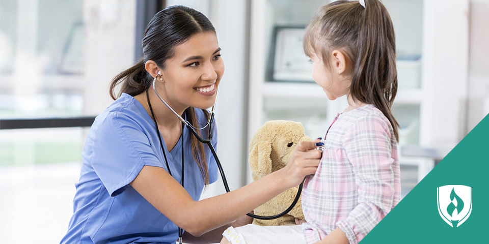 medical assistant checking child's heart rate