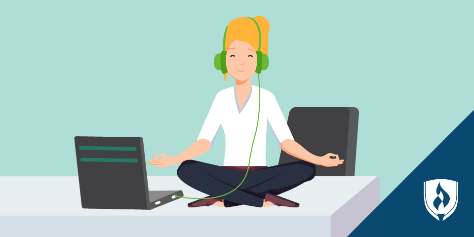 girl with headphones meditating by computer