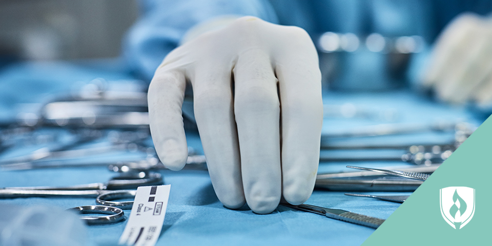 surgical tech's hand grabbing surgical tools