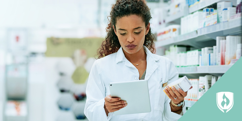 pharmacy technician stocking prescriptions in back