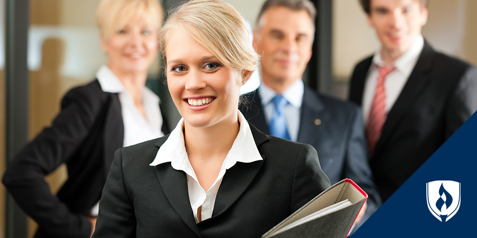 female in business dress attire with legal team in background