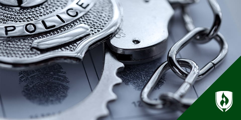 police badge on top of handcuffs