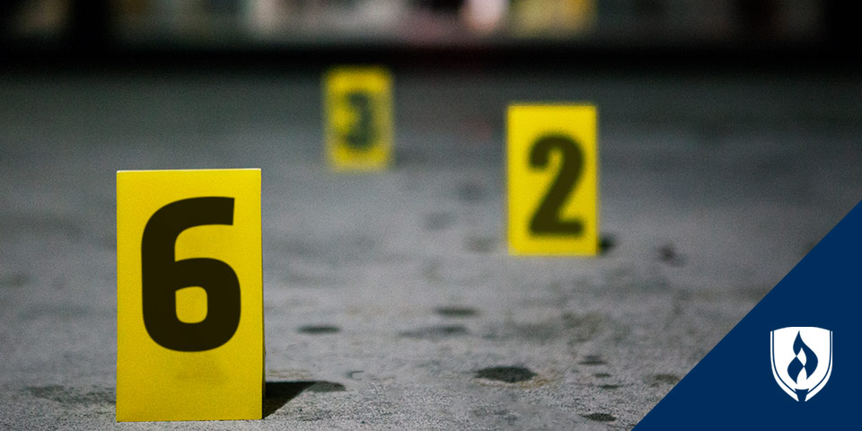 crime scene markers numbers on cement ground