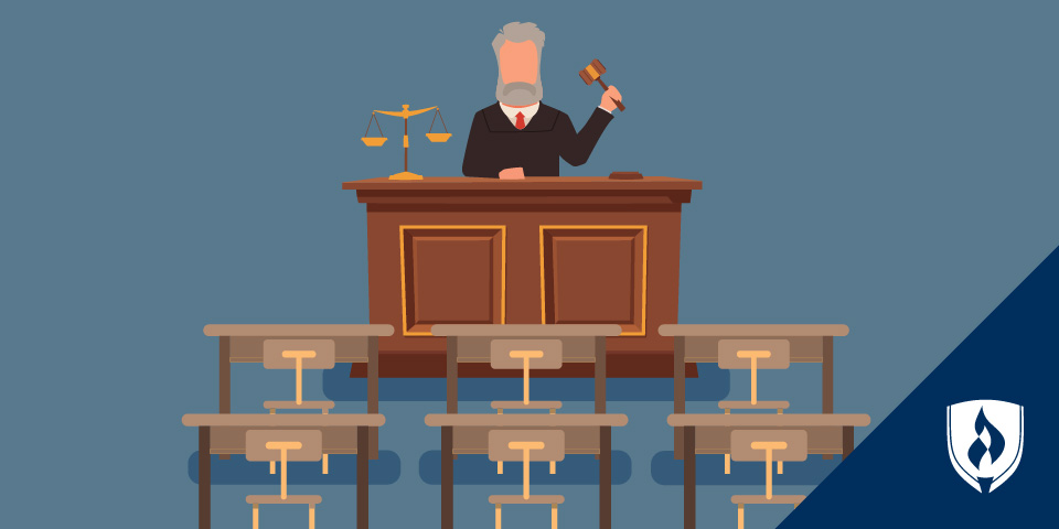 judge sitting in front of empty desks