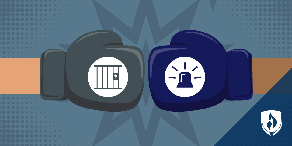 boxing gloves with icons depicting a jail cell and a siren
