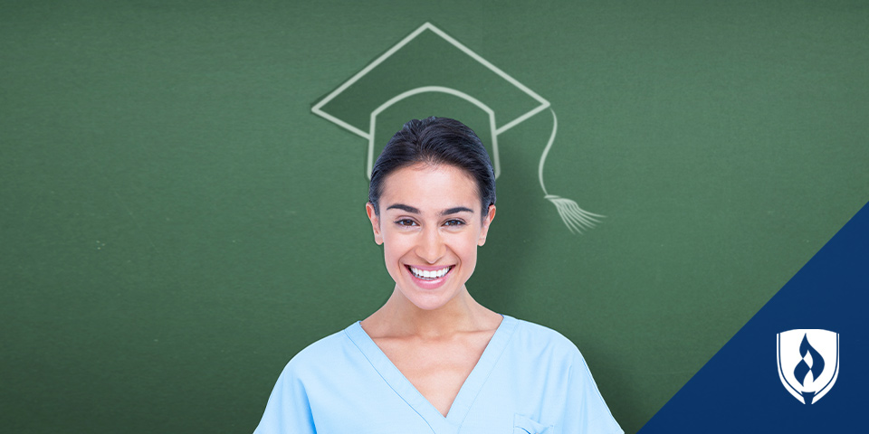 female nurse with a chalk drawn graduation hat