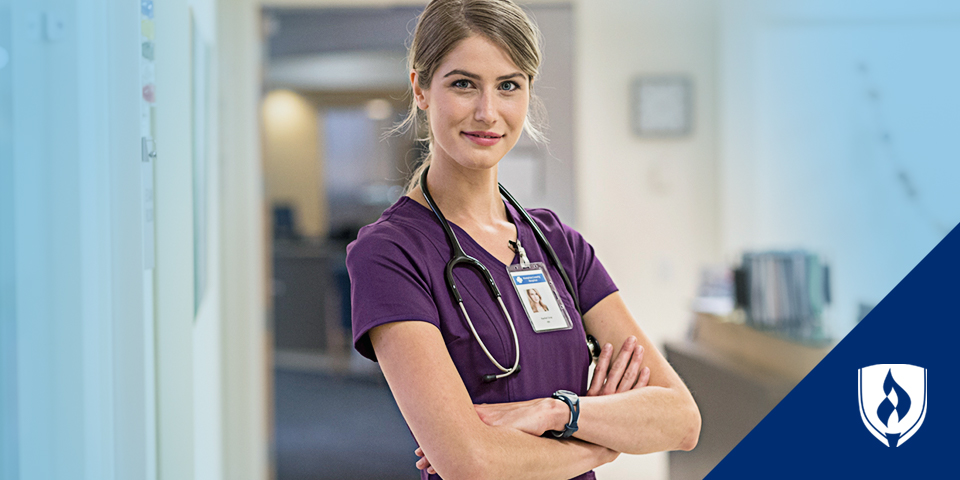 Female nurse standing with arms crossed