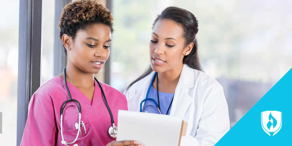 female doctor discussing a chart with female nurse