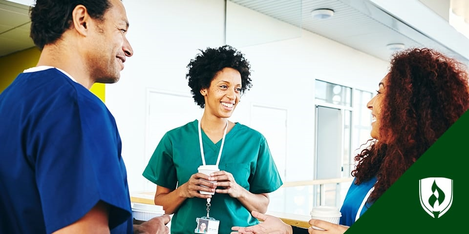 female nurse speaking with smiling patient