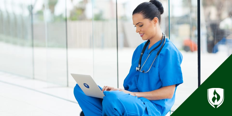 female nurse working on laptop