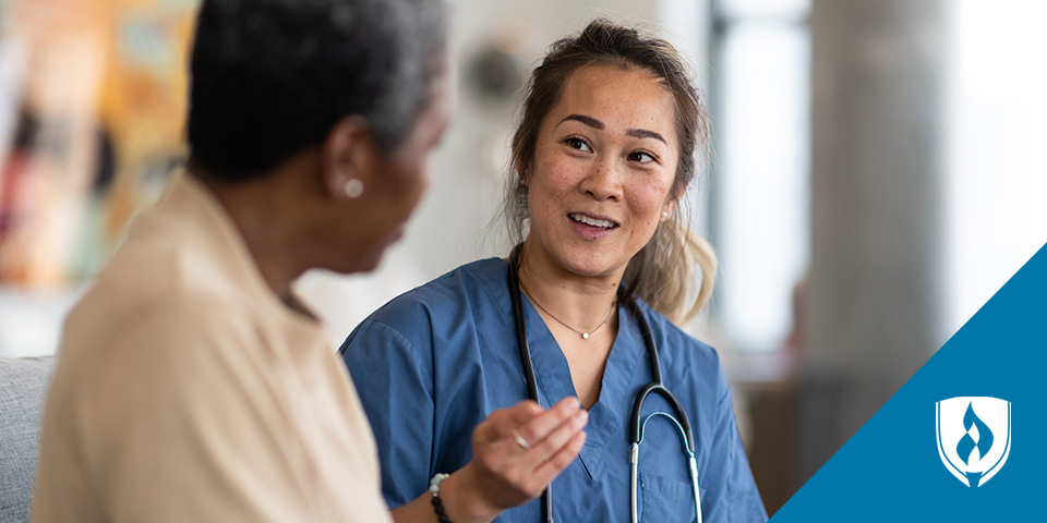 nurse speaking with female patient