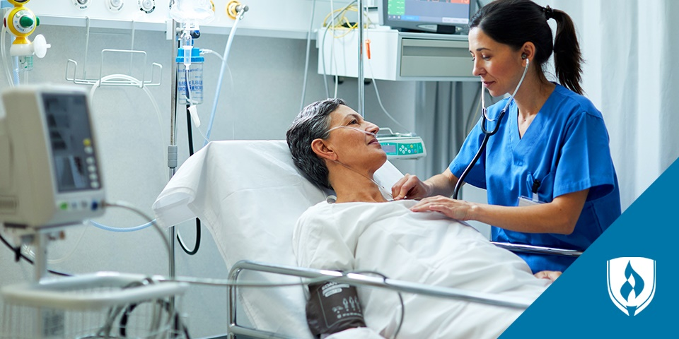photo of a nurse auscultating on a patient in a hospital bed