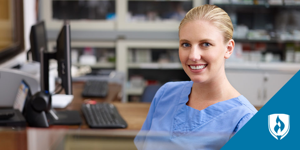 female nurse smiling at computer