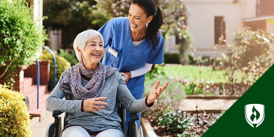 a long term care nurse taking a patient outside