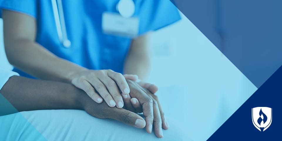nurse holding patients hand with blue overlay