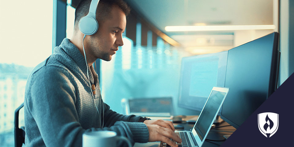 web developer with headphones using a laptop