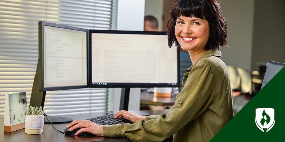 woman working on computer at desk