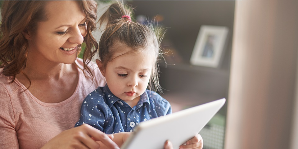 photo of a mom and toddler playing on a tablet