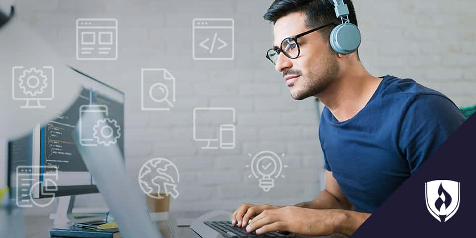 web designer with headphones working on computer