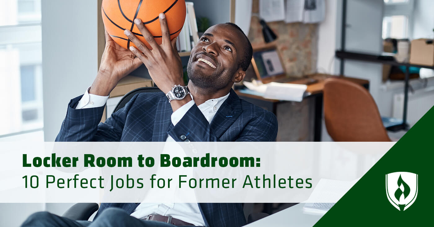 business man sitting at office desk with basketball in hands
