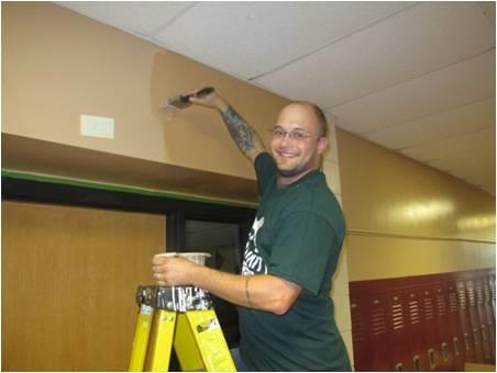Volunteering painting and cleaning high school at Blaine campus