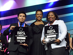 women receiving DECA award